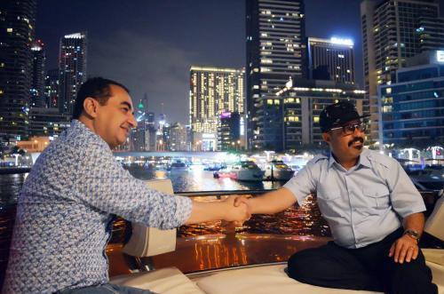 Mohamed Dekkak & Abderrahim Khaoutem enjoying the evening breeze on a Luxurious Yacht in Dubai
