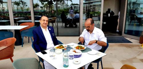 Mohamed Dekkak and Abderrahim Khaoutem enjoys their food in W Dubai- The Palm