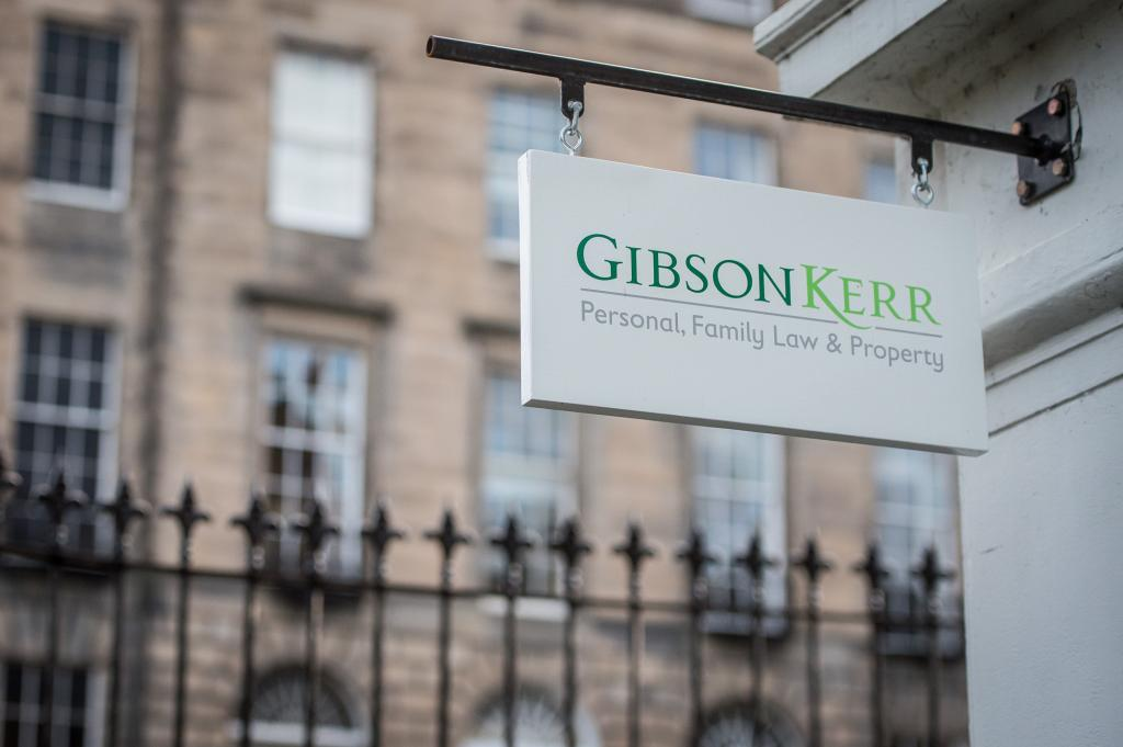 Gibson Kerr sign with view of India Street